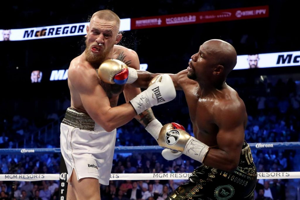 Mayweather en McGregor in de boksring